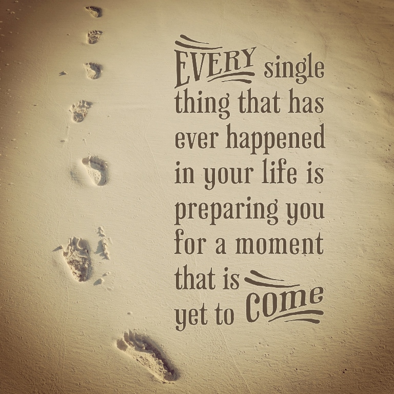 Quote on sand background with footsteps
